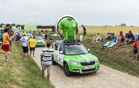 sponsors: Quievy,France - July 07, 2015: Skoda Caravan during the passing of the Publicity Caravan on a cobblestoned road in the stage 4 of Le Tour de France on July 7 2015 in Quievy, France. Skoda is the official car of the competition and sponsors the Green Jerse Editorial