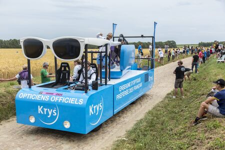 sponsors: Quievy,France - July 07, 2015:Krys vehicle during the passing of the Publicity Caravan on a cobblestoned road in the stage 4 of Le Tour de France on July 7 2015 in Quievy, France. Krys is an important chain of optical stores in France. Krys sponsors the W Editorial
