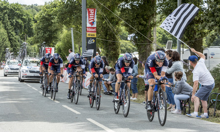 bystanders: Plumelec, France - 12 July, 2015: Team IAM Cycling riding the Team Time Trial stage between Plumelec and Vannes, during Tour de France on 12 July, 2015. Editorial