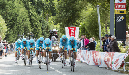 bystanders: Plumelec, France - 12 July, 2015: Team Astana riding the Team Time Trial stage between Plumelec and Vannes, during Tour de France on 12 July, 2015.