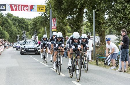 bystanders: Plumelec, France - 13 July, 2015: Team Etixx-Quick Step riding the Team Time Trial stage between Plumelec and Vannes, during Tour de France on 13 July, 2015.
