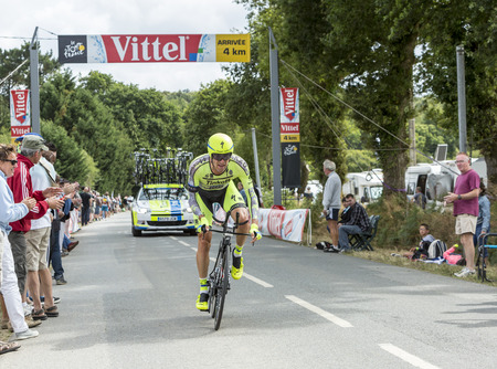 bystanders: Plumelec, France - 13 July, 2015: The Italian cyclist Matteo Tosatto of Thinkoff Saxo Team riding the Team Time Trial stage between Plumelec and Vannes, during Tour de France on 13 July, 2015.