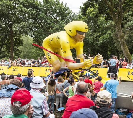 bystanders: Plumelec, France - 12 July, 2015: The LCL yellow mascot during the passing of the Publicity Caravan before the Team Time Trial stage between Plumelec and Vannes, during Tour de France on 12 July, 2015.LCL was the largest bank in France and sponsored conti