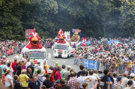 bystanders: Plumelec, France - 12 July, 2015: Le Gaulois caravan during the passing of the Publicity Caravan before the Team Time Trial stage between Plumelec and Vannes, during Tour de France on 12 July, 2015.Le Gaulois is an important French producer of poultry mea