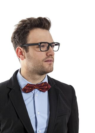 profil: Profil of a young businessman with a red bow and spectacles, against a white background. Stock Photo