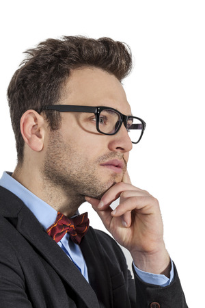 man style: Profil of a young businessman with a red bow and spectacles, against a white background. Stock Photo