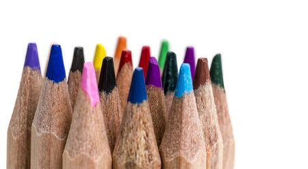 tip up: Macro shot of colored pencils tips against a white background.