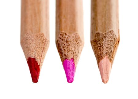 nuances: Three tips of wooden pencils in various shades of red isolated against a white background.