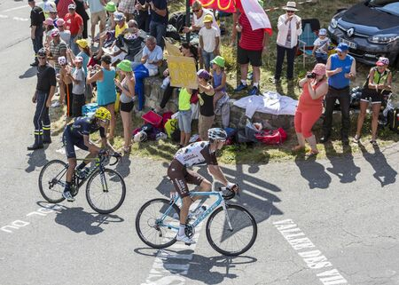 gomez: Col du Glandon, France - July 23, 2015: Romain Bardet of AG2R La Mondiale Team and Anacona Gomez of Movistar Team riding in a beautiful curve at Col du Glandon in Alps during the stage 18 of Le Tour de France 2015. These were the first riders in the top a