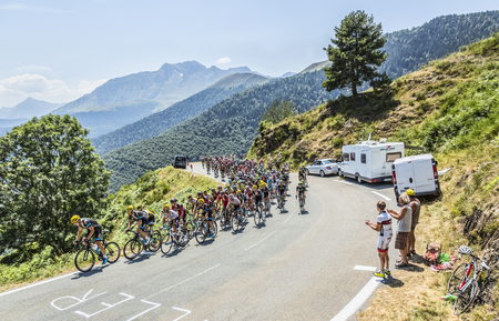 mountain bicycling: Col DAspin,France- July 15,2015: The peloton climbing the road to Col DAspin  in Pyrenees Mountains during the stage 11 of Le Tour de France 2015.