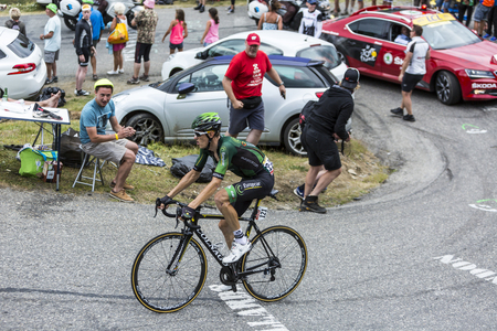bystanders: Col du Glandon, France - July 24, 2015: The French cyclist Pierre Rolland of Europcar Team,climbing the road to Col du Glandon in Alps, during the stage 19 of Le Tour de France 2015.