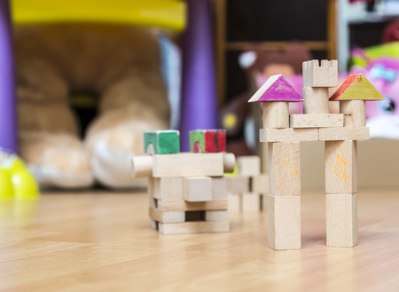 children play: Image of a castle made by wooden pieces in a children play room.
