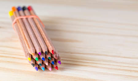 color pencil: Image of a bundle of colored pencils on a wooden table. Stock Photo