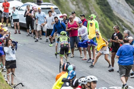 bystanders: Col du Glandon, France - July 24, 2015: The British cyclist Dan Martin of Cannondale-Garmin Team,climbing the road to Col du Glandon in Alps, during the stage 19 of Le Tour de France 2015.
