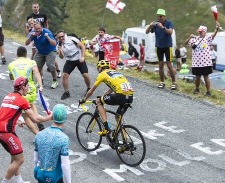 bystanders: Col du Glandon, France - July 24, 2015: The British cyclist Chris Froome of Team Sky in Yellow Jersey,climbing the road to Col du Glandon in Alps, during the stage 19 of Le Tour de France 2015.