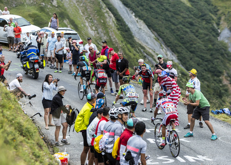 bystanders: Col du Glandon, France - July 24, 2015: Group of four cyclists including Polka Dot Jersey,Joaquim Rodriguez of Katusha Team,climbing the road to Col du Glandon in Alps, during the stage 19 of Le Tour de France 2015.