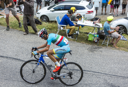 bystanders: Col du Glandon, France - July 24, 2015: The Italian cyclist Vincenzo Nibali of AstanaTeam,climbing the road to Col du Glandon in Alps, during the stage 19 of Le Tour de France 2015.