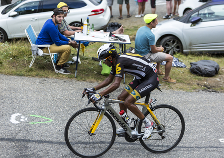 bystanders: Col du Glandon, France - July 24, 2015: The Eritrean cyclist Merhawi Kudus Ghebremedhin of MTN-Qhubeka Team,climbing the road to Col du Glandon in Alps, during the stage 19 of Le Tour de France 2015. Editorial