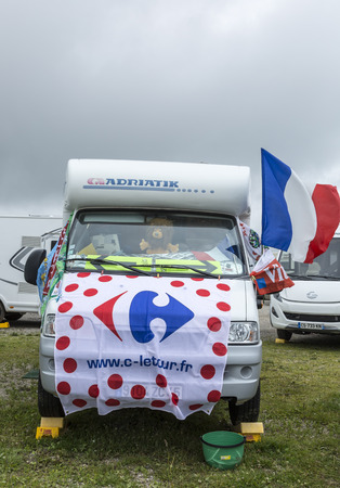 carrefour: Le Markstein, France- July 13, 2014: Fancy decorated caravan on the side of the road to the mountain pass Le Markstein during the stage 9 of Le Tour de France 2014. Editorial
