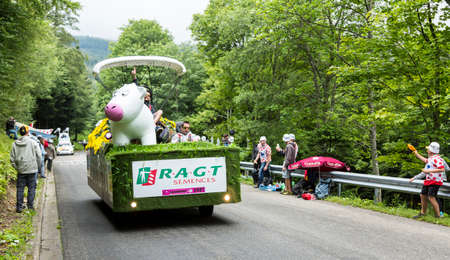 carrefour: Le Markstein, France- July 13, 2014:RAGT Semences vehicle during the passing of the Publicity Caravan on mountain pass Le Markstein during the stage 9 of Le Tour de France 2014.RAGT Semences is an important french producer of variuos types of seeds.