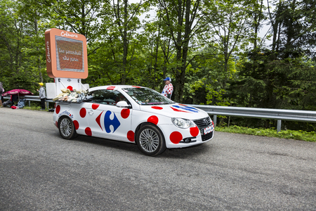 carrefour: Le Markstein, France- July 13, 2014:The fancy Carrefour vehiclee during the passing of the Publicity Caravan on mountain pass Le Markstein during the stage 9 of Le Tour de France 2014. Editorial