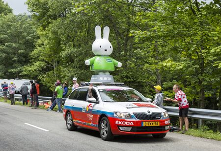 Le Markstein, France- July 13, 2014:Nijntje Miffy vehicle during the passing of the Publicity Caravan in front of exciting spectators, on mountain pass Le Markstein during the stage 9 of Le Tour de France 2014.Nijntje is the protagonist of a series of chi