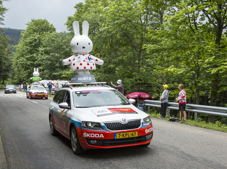 Le Markstein, France- July 13, 2014:Nijntje Miffy Caravan during the passing of the Publicity Caravan in front of exciting spectators, on mountain pass Le Markstein during the stage 9 of Le Tour de France 2014.Nijntje is the protagonist of a series of chi Editorial
