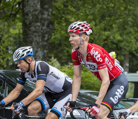 mount tom: Le Markstein, France- July 13, 2014:The cyclists Marcel Sieberg of Lotto-Belisol and Tom Veelers of Giant-Shimano Team, climbing the road to mountain pass Le Markstein during the stage 9 of Le Tour de France 2014. Editorial