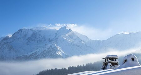 scenic  landscape: Close-up of a top of a chalet in front of a beautiful Mont Blanc winter landscape
