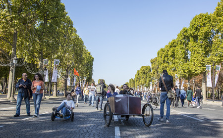 champs elysees: Paris,France - September 27, 2015: People walking and riding unusual velo-vehicles on Champs Elysees during the Day without cars held in some areas in Paris on September 27,2015.