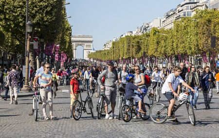champs elysees: Paris,France - September 27, 2015: Group of people on bicycles on Champs Elysees during the Day without cars held in some areas in Paris on September 27,2015. Editorial