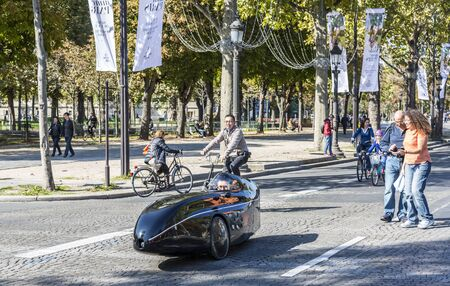 champs elysees: Paris, France - September 27, 2015: People walking and driving unusual velo-vehicles on Champs Elysees during the Day without cars held in some areas in Paris on September 27,2015. Editorial