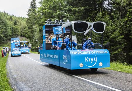 mountain bicycling: Col de Platzerwasel,France - July 14, 2014: The vehicles of Krys during the passing of the Publicity Caravan in front of excited spectators on the road to mountain pass Platzerwasel in Vosges Mountains, in the stage 10 of Le Tour de France 2014.Krys is a
