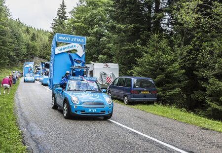 event marketing: Col de Platzerwasel,France - July 14, 2014: The vehicles of Krys during the passing of the Publicity Caravan in front of excited spectators on the road to mountain pass Platzerwasel in Vosges Mountains, in the stage 10 of Le Tour de France 2014.Krys is a
