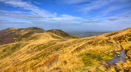 massif: Beautiful autumn landscape in volcanic mountains in The Central Massif in France. Stock Photo