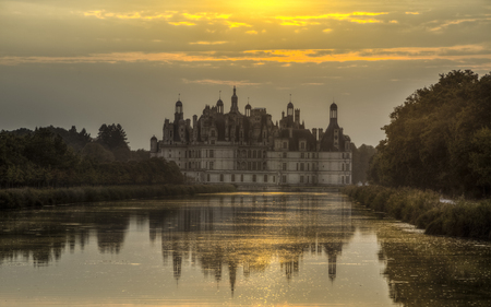 Chateau de Chambord, Loire Valley, France - sunset image with reflections in the canal. Stock Photo