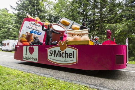 st michel: Col de Platzerwasel, France - July 14, 2014: Fancy vehicle of St. Michel Madeleines passing in the Publicity Caravan on the road to mountain pass Platzerwasel, in Vosges Mountains during the stage 10 of Le Tour de France on 23 July 2014.