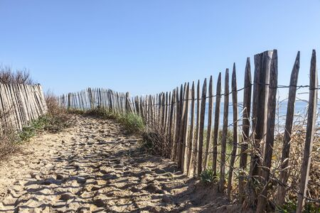 atlantic ocean: Footpath between wooden fences on the Atlantic Dune in Brittany, in north-west of France.