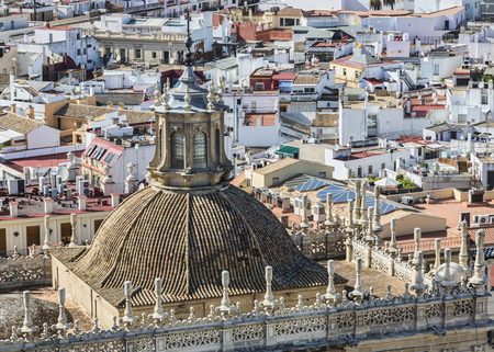 vicinity: Image of the tower of The Sanctuary of the Cathedral of Seville in front of a rooftops view in its vicinity Stock Photo