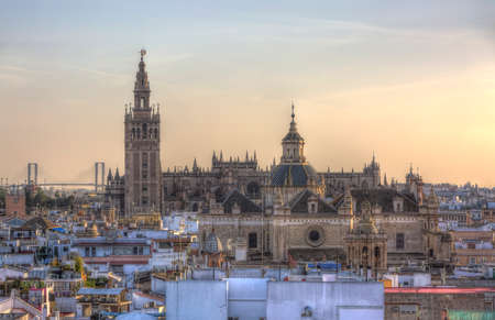 authorities: Image at the sunset of the great Cathedral of Seville in Andalusia, Spain. This is a symbolic landmark of Seville and the authorities prohibit any other building in the center of the Andalusian capital to reach its height.