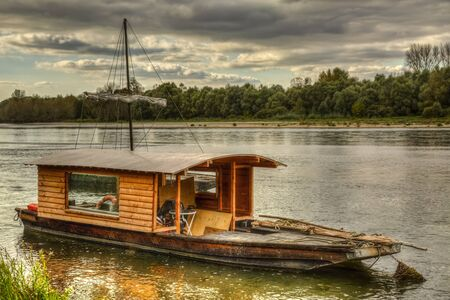 wooden boat: Wooden boat on the Loire Valley in France during an autumn evening day.