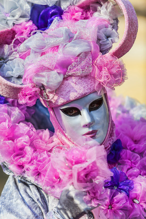 disguised: Annecy, France- February 24, 2013:Portrait of an unidentified person disguised in a beautiful costume in Annecy, France, during a Venetian Carnival, which is held yearly, to celebrate the beauty of the real Venice.