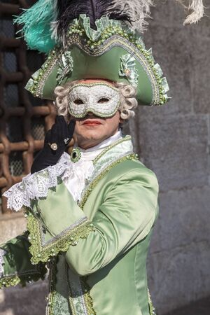 cel: Venice, Italy- February 18th, 2012: Portrait of a man disguised in a beautiful costume as the count Casanova posing during the Venice Carnival days.