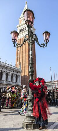 campanille: Venice, Italy-February 18, 2012:Image of a person wearing a complex disguise during The Venice Carnival days.