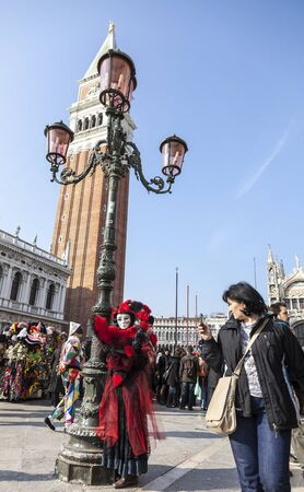 campanille: Venice, Italy-February 18, 2012:Tilted image of a person wearing a complex disguise during The Venice Carnival days.