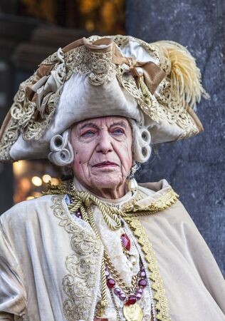 wrinkled: Venice,Italy- March 2, 2014: Portrait of a medieval nobleman posing in San Marco Square during the Venice Carnival days.