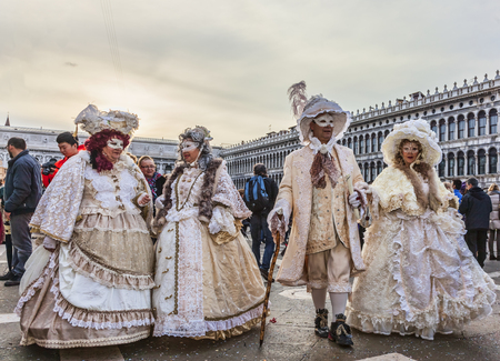 venice carnival: Venice,Italy- March 2, 2014: Group of disguised people posing in San Marco Square during the Venice Carnival days.