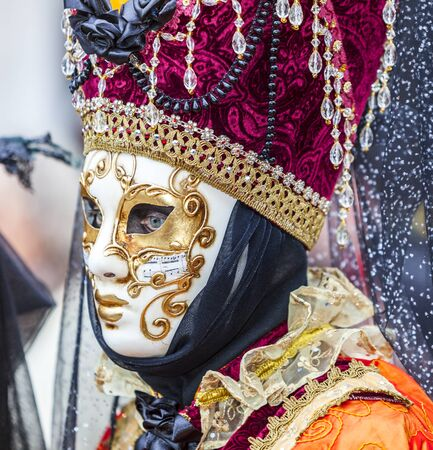 venice carnival: Venice,Italy- March 2, 2014: Portrait of a person with a Venetian mask in San Marco Square during the Venice Carnival days.