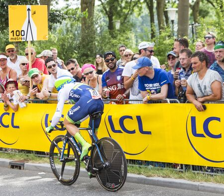 bystanders: Utrecht,Netherlands - 04 July 2015: The Swiss cyclist Michael Albasini of  Team OricaGreenEDGE riding during the first stage individual time trial  of Le Tour de France 2015 in Utrecht,Netherlands on 04 July 2015. Editorial