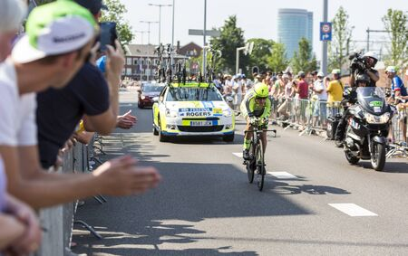 bystanders: Utrecht,Netherlands - 04 July 2015: The Australian cyclist Michael Rogers of Tinkoff-Saxo Team riding during the first stage individual time trial  of Le Tour de France 2015 in Utrecht,Netherlands on 04 July 2015. Editorial